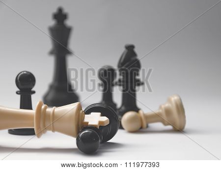 chess battle - fallen king - plastic chess pieces