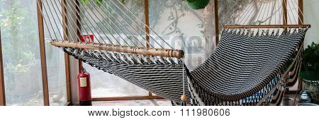 Big huge Hammock in black and white hanging inside a patio