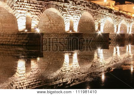 Roman Bridge Over Guadiana River At Night, Merida