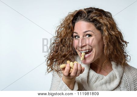 Fun Young Woman With A Peanut In Her Mouth