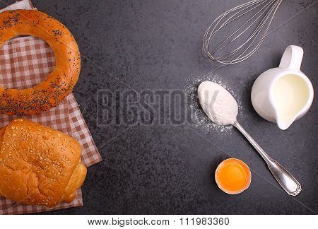 Baking Ingredients, Flour, Egg, Milk, And Whisk. Bagel, Croissant.