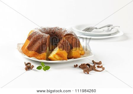 sliced marble bundt cake on white plate