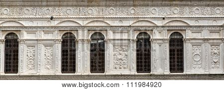 Beautiful old white facade at a historic building with stone carvings and decorations