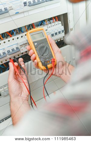 Electrician using multi meter