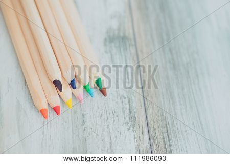 Assortment of colored pencils/Colored Drawing Pencils/Colored drawing pencils in a variety of colors on vintage wooden background