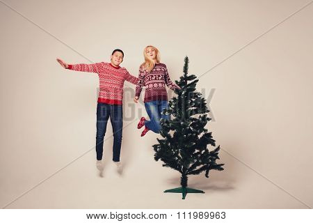 Young Man And Woman Leaping High In The Air