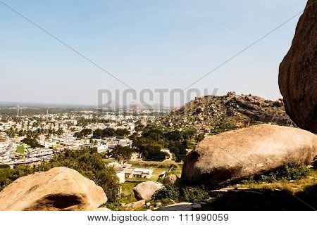 Aerial view of a densely populated town from the cliff or mountain