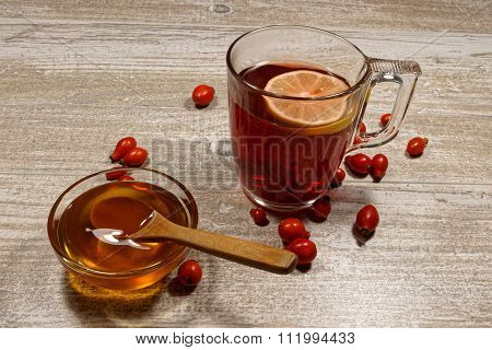 Rose hip tea with honey and lemon