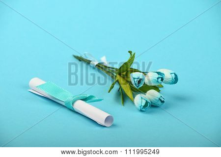 One Paper Message And Flowers On Blue Background
