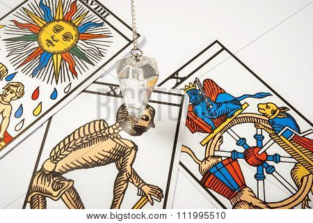White Crystal Pendulum With Tarot Cards