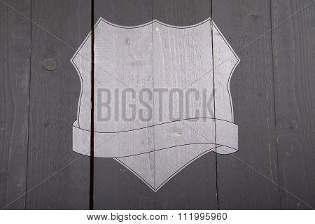 White Shield On Black Wooden Background