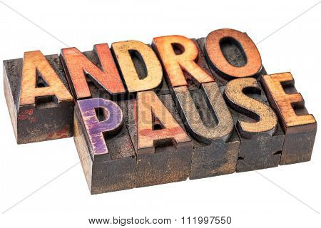 andropause - male menopause - isolated word abstract n vintage wood letterpress printing blocks stained by color inks