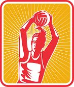 picture of netball  - illustration of a netball player ready to pass ball with shield or triangle in the background - JPG