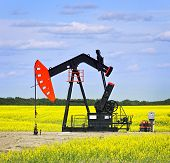 image of nod  - Oil pumpjack or nodding horse pumping unit in Saskatchewan prairies Canada - JPG
