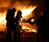 stock photo of guy fawks  - people around a bonfire guy fawkes night uk - JPG