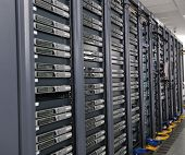stock photo of raid  - internet network server room with computers racks and digital receiver for digital tv - JPG