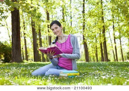 Student Enjoying With Book In Nature