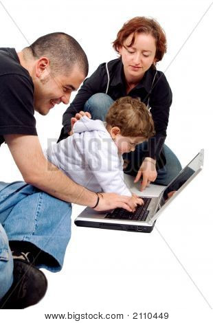 Parents And Kid On A Laptop