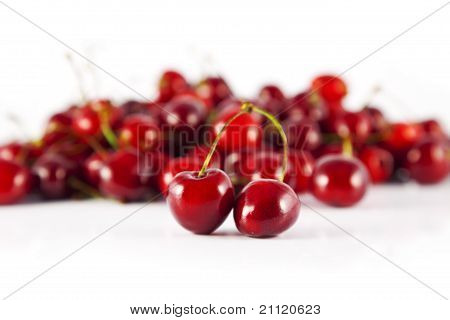 two cherries in front of