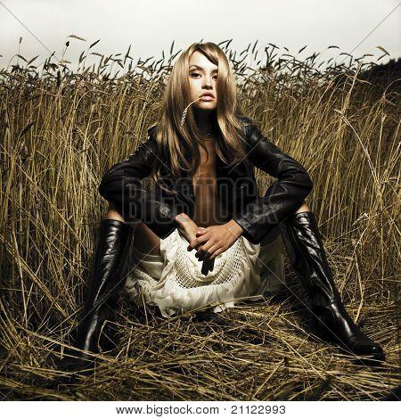 Portrait of sensual blond girl in wheat