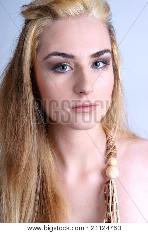 Portrait of pretty blonde wearing wooden beads