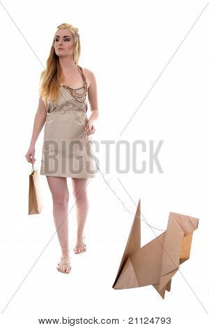 Young woman walking eco dog holding recycle bag