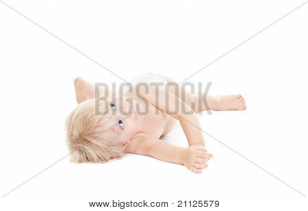 Adorable Baby Girl Lying Down And Looking Up
