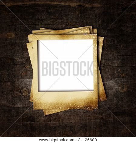 Old Photo Frame On Wooden Background