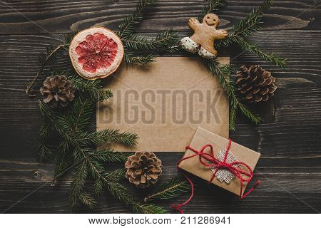 poster of Christmas Background. Christmas Decoration With Fir Branches And Christmas Gift On The Wooden Table