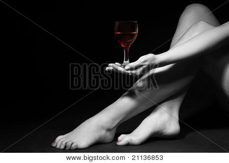 Beautiful Girl Legs And A Glass Of Red Wine