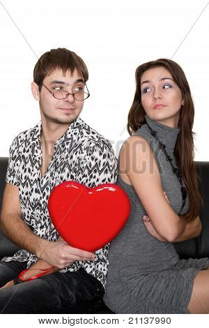 Funny Nerd Guy Gives A Valentine Glamorous Girl Isolated On White