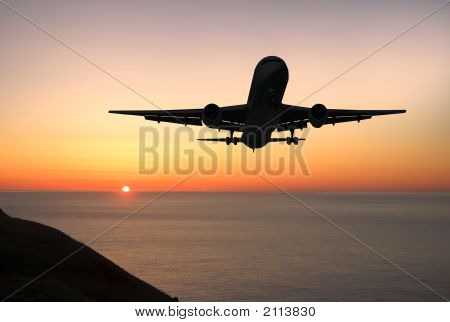 Airliner Landing At Sunrise