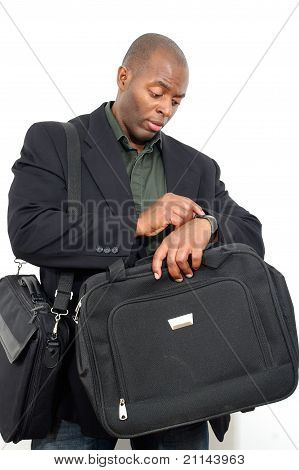 african american business man looking at time
