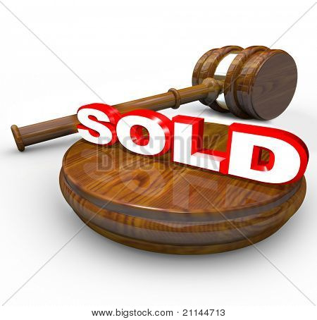 A gavel comes down on the word Sold to signify the end or closing of an auction and the buyer has been the highest bidder on an item