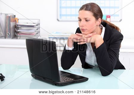 Brunette businesswoman bored at work