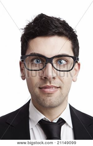 Funny portrait of a young businessman with crooked eyes wearing nerd glasses