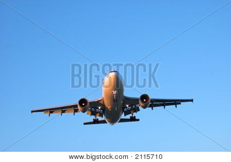 Wide Body Airliner In Blue Sky