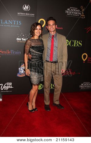 LAS VEGAS - JUN 19:  Rebecca Budig, Greg Rikaart arriving at the  38th Daytime Emmy Awards at Hilton Hotel & Casino on June 19, 2010 in Las Vegas, NV.