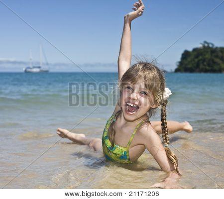 Emotion girl at sea coast. Tourism.