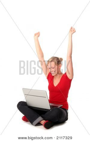 Girl Sitting On Floor Using Laptop