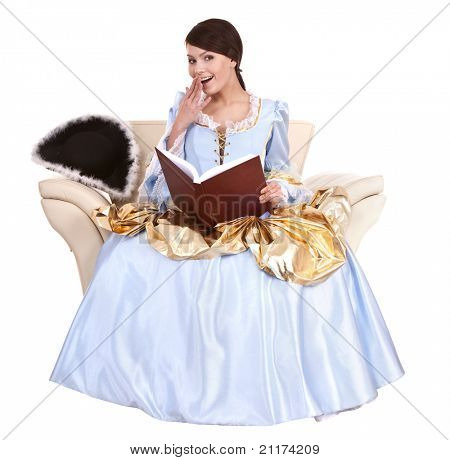 Girl in blue long dress with book on chair.Isolated.