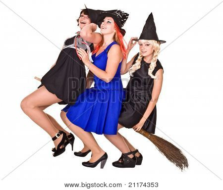 Group Halloween witch  in black dress and hat fly on broom.Isolated.