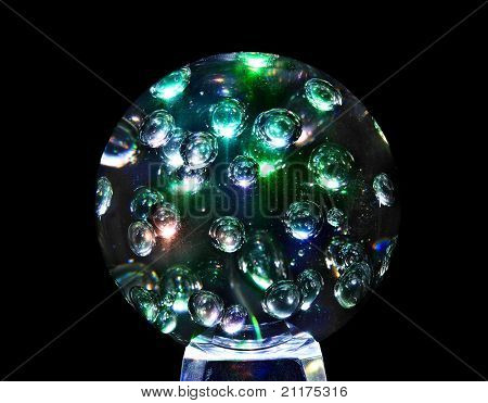Mystic magic glass sphere ball. Isolated black background.