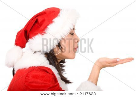 Female Santa Blowing Her Hand