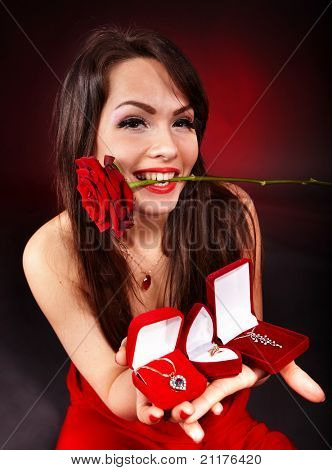 Girl with group jewellery gift box and rose on red  background.   Valentines day.