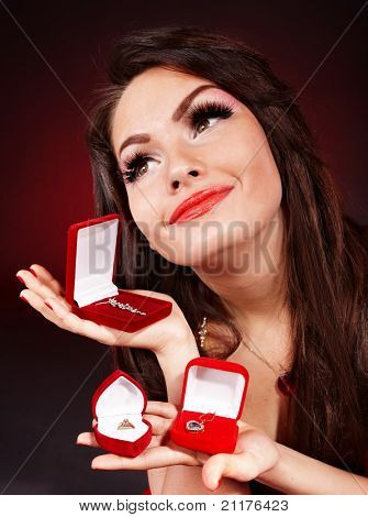 Girl with group jewellery gift box on red  background. Valentines day.