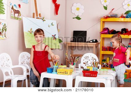 Group of children preschooler with colour pencil in play room.