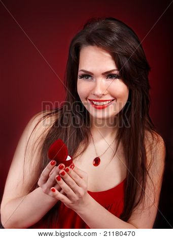 Girl with jewellery box on red background. Valentines day.