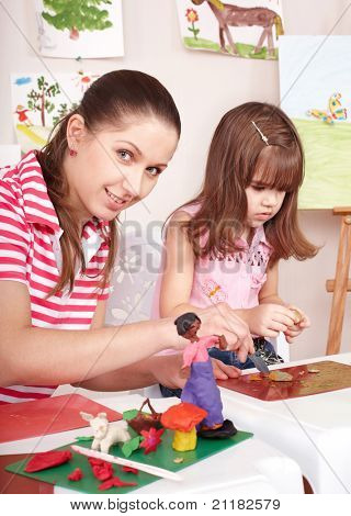 Mother and  daughter playing  plasticine. Child care.