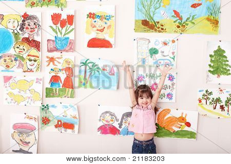 Child in art class with picture. Preschool.